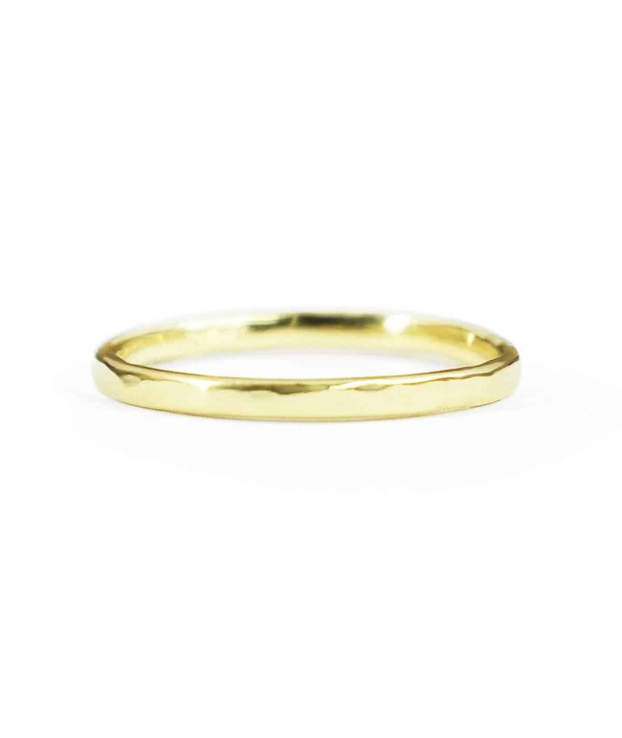 yellow gold thin hammered wedding band