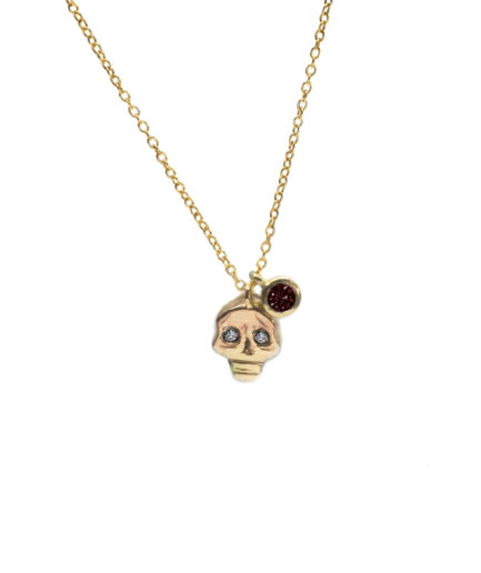 skull pendant and ruby charm